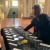 Sheila Mercieca, the Society's Archivist, showing a delegate the Statements Table