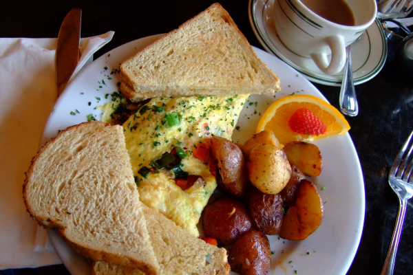 Breakfast of omelette, potatoes and toast