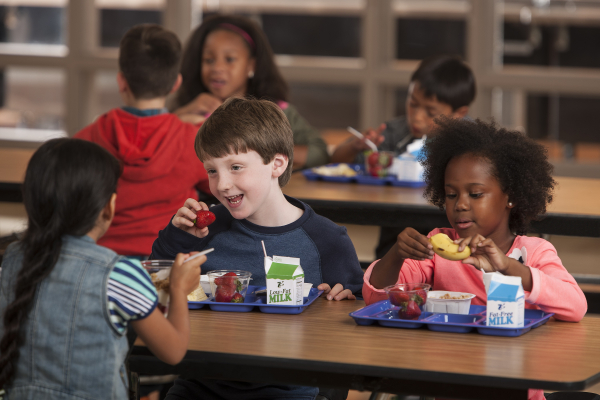 Children eating in a library