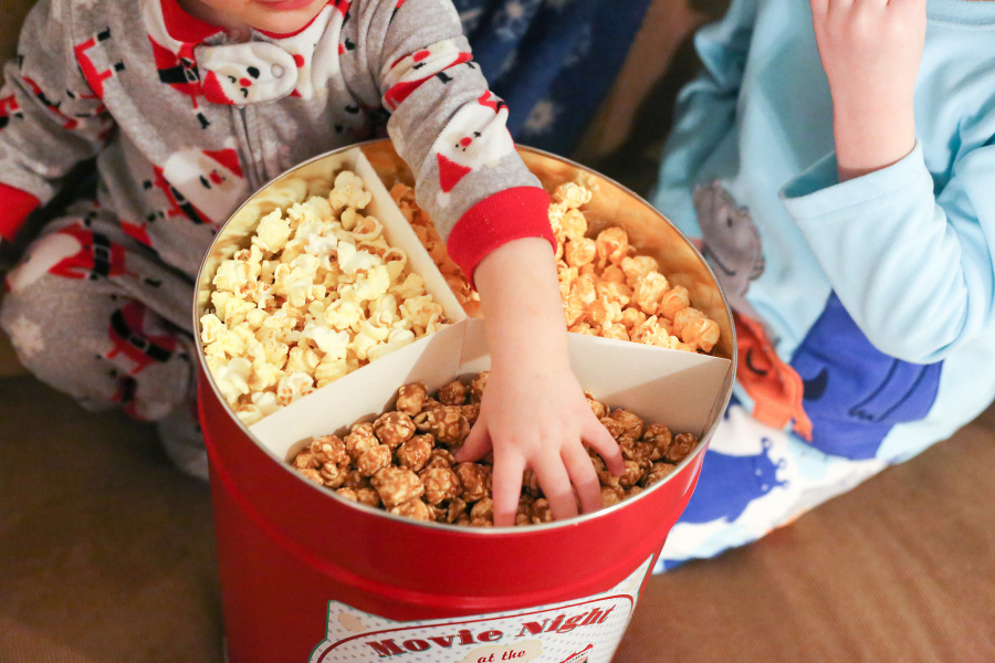 Child eating popcorn whilst watching a movie