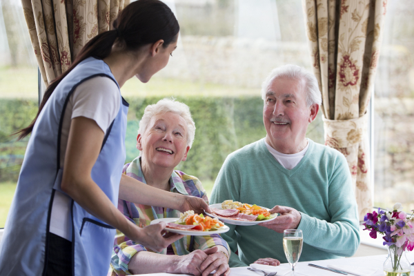 Elderly people dining in a carehome