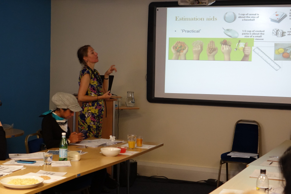 Dr Kathryn Hart presenting on estimation aids during workshop
