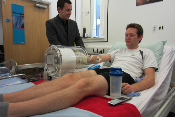 James Betts taking blood from a participant in his breakfast study