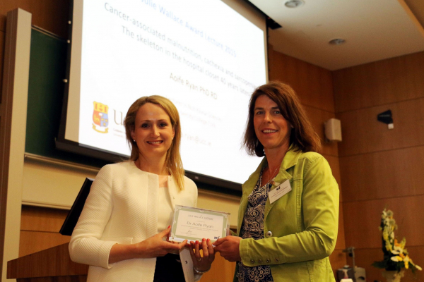 Dr Ryan receives the Julie Wallace Medal from Professor Alison Gallagher
