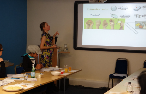 Dr Kathryn Hart presenting on estimation aids during workshop