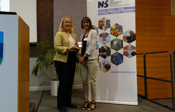 Dr Charlotte Evans receives the Medal from past President, Professor Catherine Geissler