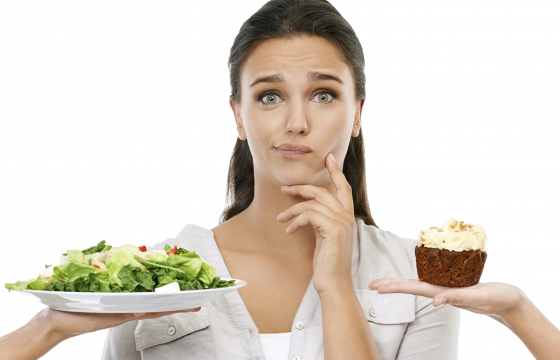 Women selecting between salad and cake