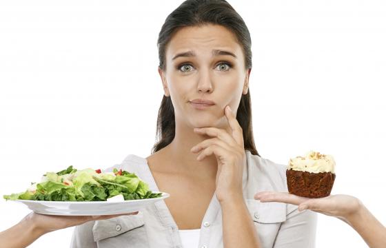 Women selecting between salad and cake